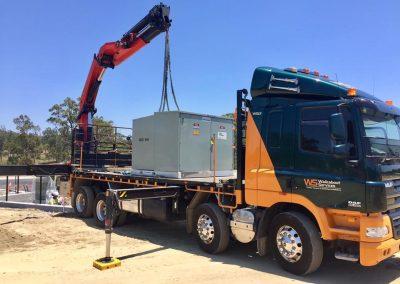 walkabout crane truck lifting silver metal box