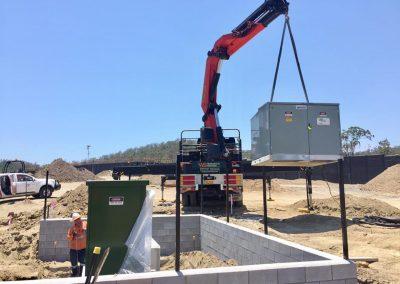 walkabout crane lifting large silver box