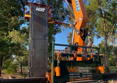 walkabout crane putting up aos metal post