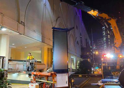 crane lifting tall led screen